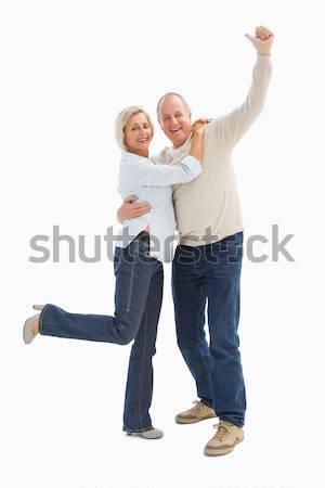 Gelukkig volwassen paar juichen camera witte Stockfoto © wavebreak_media