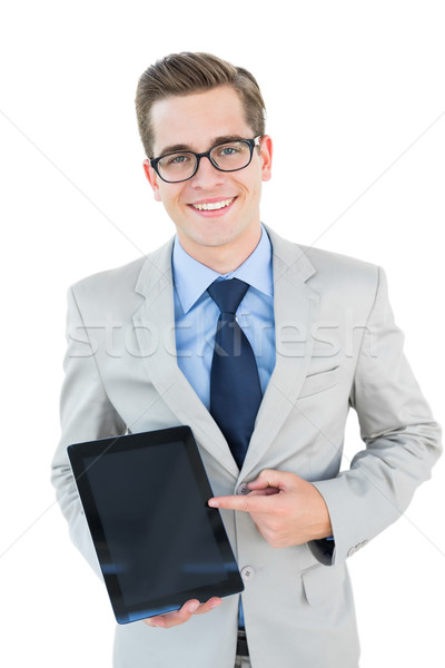 Geeky businessman pointing to tablet pc Stock photo © wavebreak_media