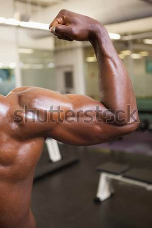 Muscular man in an over sized pants at gym Stock photo © wavebreak_media