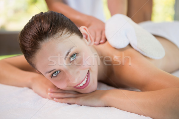 Stock photo: Attractive woman receiving back massage at spa center