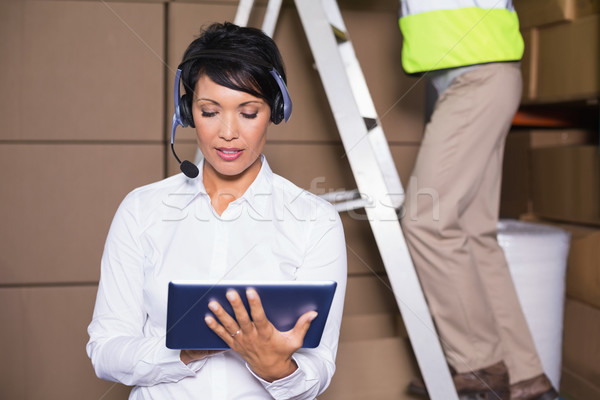 Pretty warehouse manager using tablet during busy period Stock photo © wavebreak_media