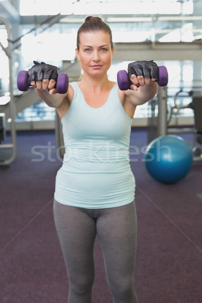 Fit brunette working out with dumbbells  Stock photo © wavebreak_media