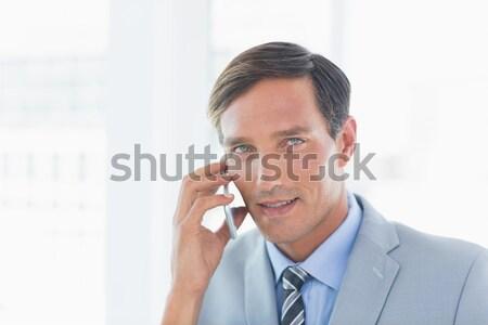Thoughtful young businessman looking away Stock photo © wavebreak_media