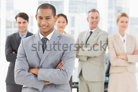 Young business people with arms crossed in office Stock photo © wavebreak_media