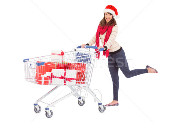 Cute woman in santa hat with shopping trolley Stock photo © wavebreak_media