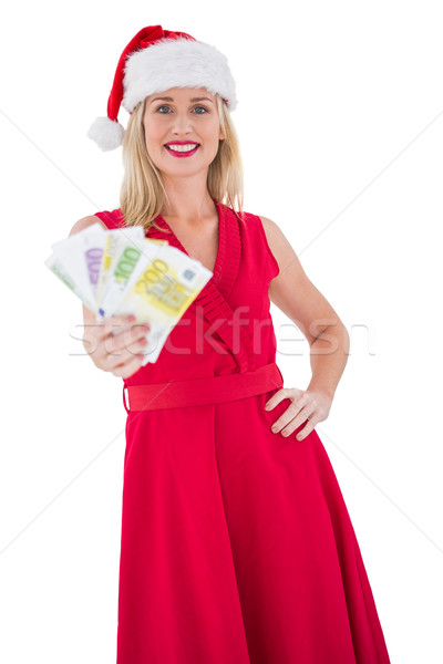 Festive blonde in red dress showing her cash Stock photo © wavebreak_media