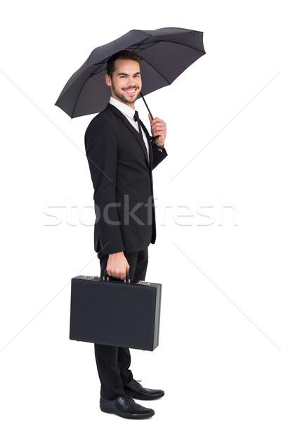 Gülen işadamı şemsiye evrak çantası beyaz takım elbise Stok fotoğraf © wavebreak_media
