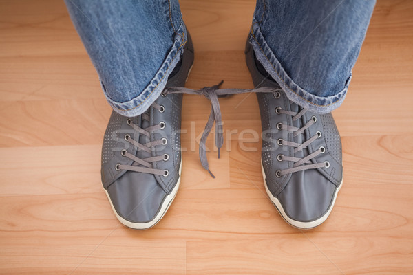 Casual mans shoelaces tied together  Stock photo © wavebreak_media
