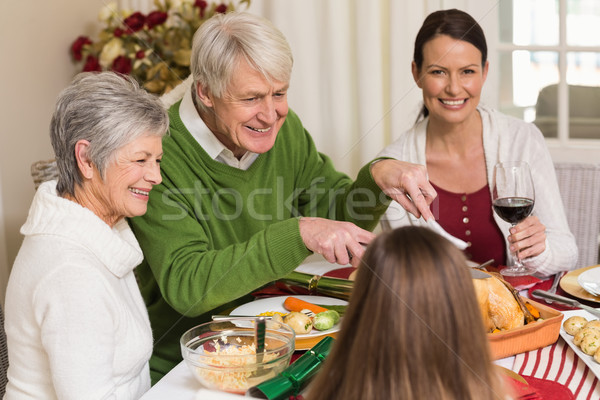 Uśmiechnięty dziadek kurczaka christmas obiedzie domu Zdjęcia stock © wavebreak_media