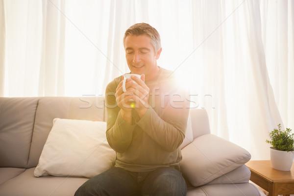 笑みを浮かべて 男 ホットドリンク ホーム リビングルーム ストックフォト © wavebreak_media