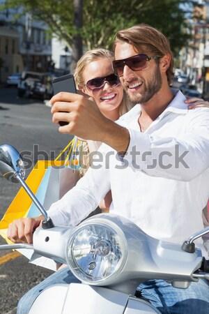 Aranyos pár lovaglás moped napos idő város Stock fotó © wavebreak_media