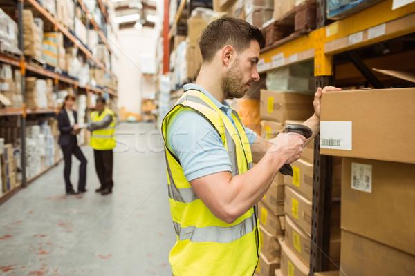 Warehouse worker scanning barcode on box Stock photo © wavebreak_media