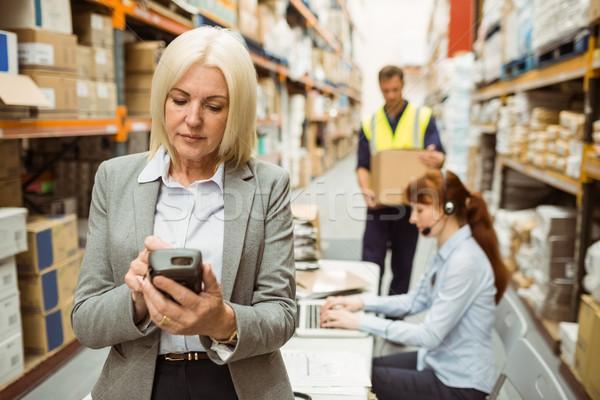 Focused warehouse manager using handheld Stock photo © wavebreak_media