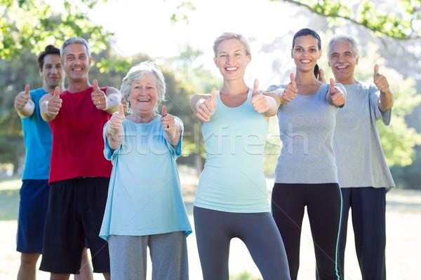 счастливым спортивный группа улыбаясь камеры Сток-фото © wavebreak_media