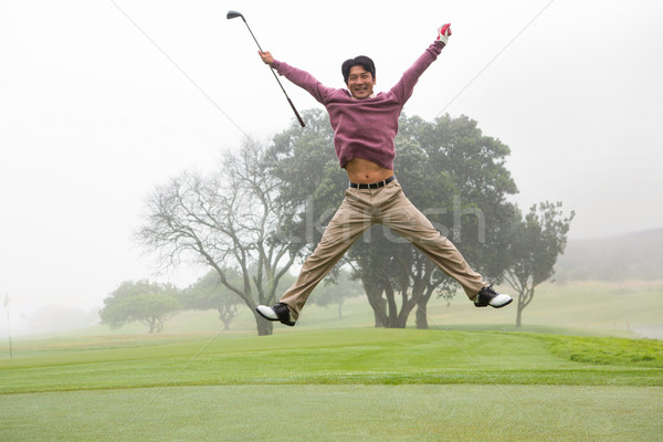 Excited golfer jumping up and smiling at camera Stock photo © wavebreak_media