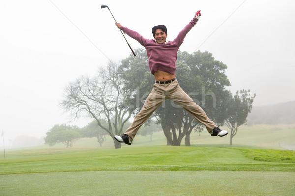 возбужденный гольфист прыжки вверх улыбаясь камеры Сток-фото © wavebreak_media