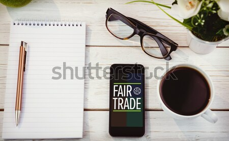 Overhead shot of notepad and smartphone Stock photo © wavebreak_media