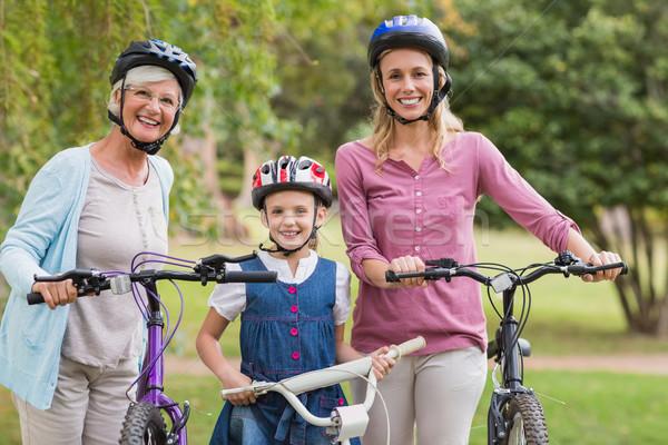 Happy multi generation family on their bike at the park  Stock photo © wavebreak_media