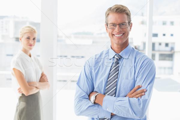 Sorridere business partner guardando fotocamera ufficio uomo Foto d'archivio © wavebreak_media