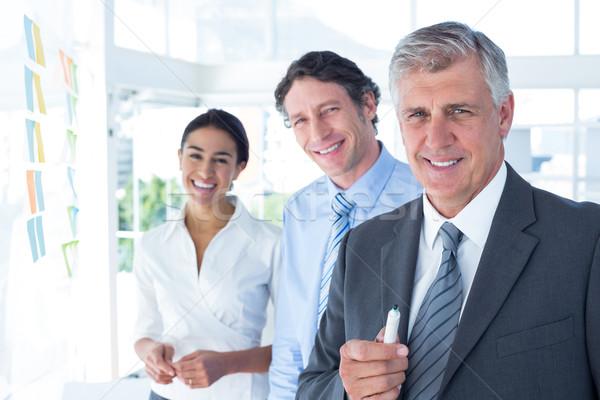Smiling business people brainstorming together Stock photo © wavebreak_media