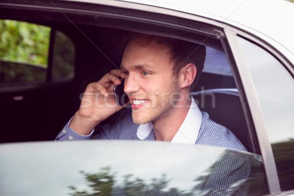 Fiatalember beszél telefon limuzin napos idő buli Stock fotó © wavebreak_media