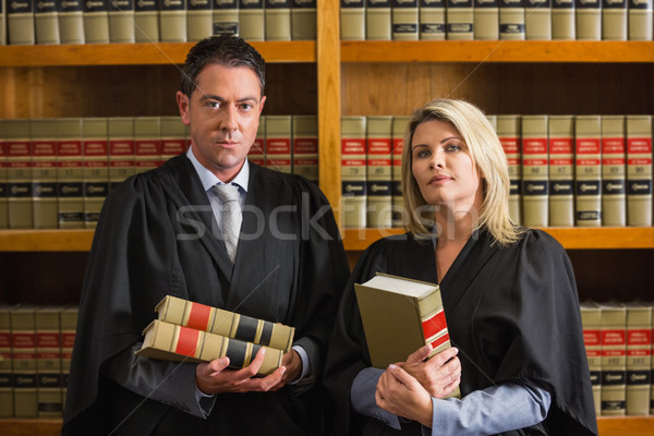 Lawyers holding books in the law library Stock photo © wavebreak_media
