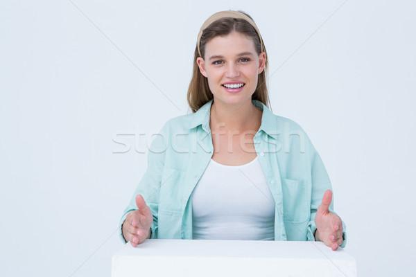 Happy hipster putting her hands on box  Stock photo © wavebreak_media