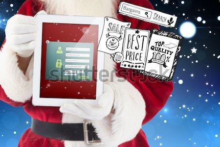 изображение Дед Мороз используя ноутбук красный компьютер Сток-фото © wavebreak_media