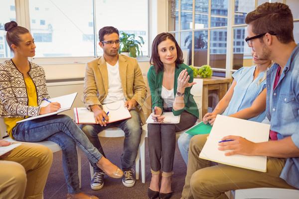 Creativo squadra di affari riunione attento ufficio mano Foto d'archivio © wavebreak_media