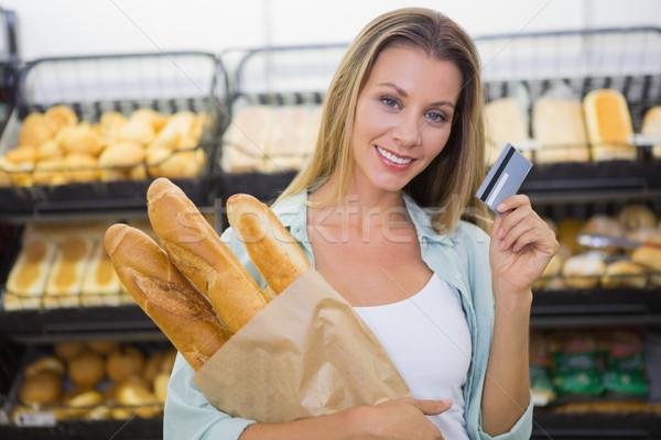Kobieta zakupu chleba półka supermarket Zdjęcia stock © wavebreak_media