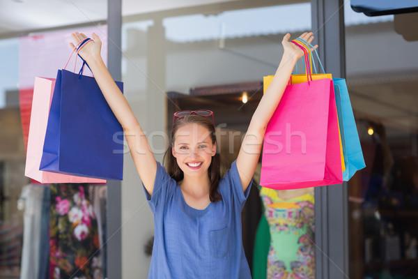 Energetic woman handing shopping bags Stock photo © wavebreak_media