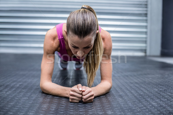 Izmos nő palánk pozició elöl kilátás Stock fotó © wavebreak_media