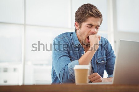 Composite image of tired businessman sitting at desk Stock photo © wavebreak_media