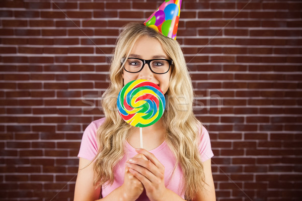 A beautiful hipster holding a giant lollipop  Stock photo © wavebreak_media
