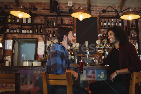Friends having beer at bar counter Stock photo © wavebreak_media