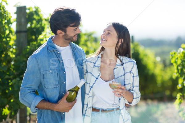 Smiling couple with wine Stock photo © wavebreak_media