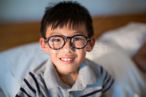 Boy in spectacles looking at camera Stock photo © wavebreak_media