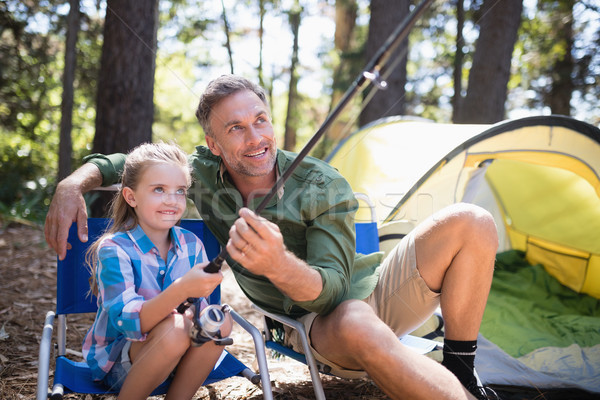 Father and daughter fishing at campsite in forest Stock photo © wavebreak_media