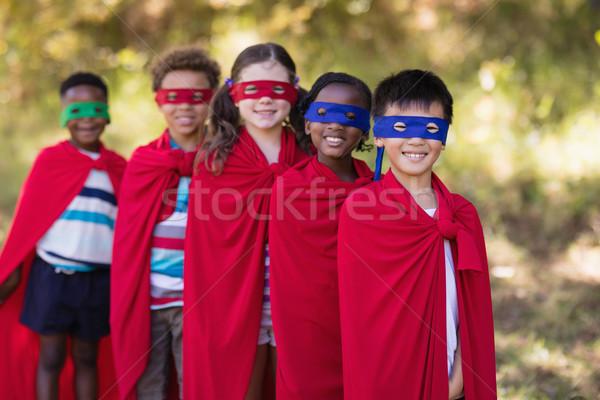 Barátok szuperhős jelmezek áll táborhely portré Stock fotó © wavebreak_media