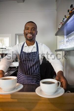Pincér felajánlás kávé pult portré étterem Stock fotó © wavebreak_media