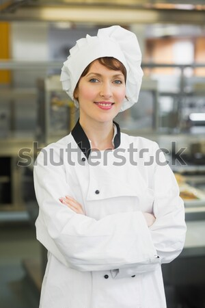 Female chef showing food dish to the camera in the commercial kitchen Stock photo © wavebreak_media