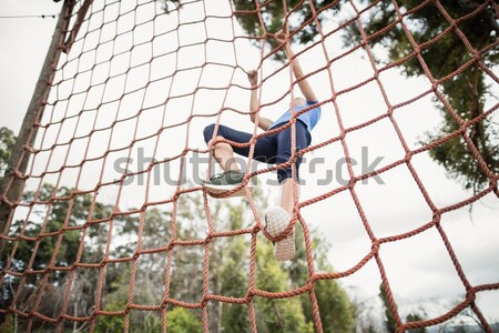 Garçon escalade net formation démarrage Photo stock © wavebreak_media