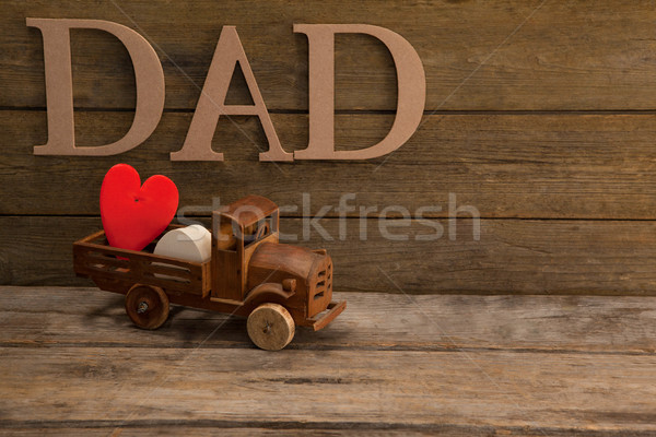 Text dad by heart shape in toy truck on table Stock photo © wavebreak_media