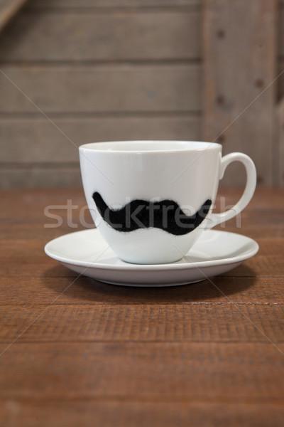 Bianco tazza di caffè baffi tavola tavolo in legno Foto d'archivio © wavebreak_media