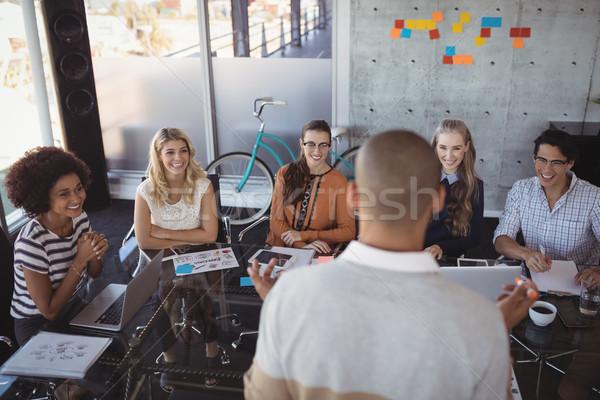 Hátsó nézet üzletember bemutató kollégák iroda tárgyalóterem Stock fotó © wavebreak_media