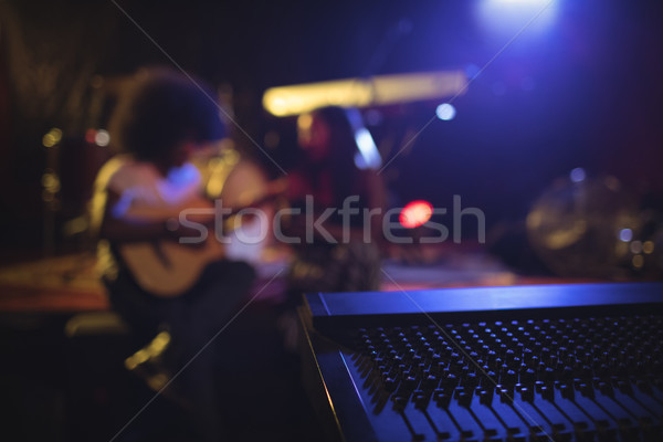 Musicians practicing with music equipment in nightclub Stock photo © wavebreak_media