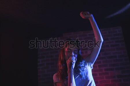 Male guitarist performing in popular music concert Stock photo © wavebreak_media