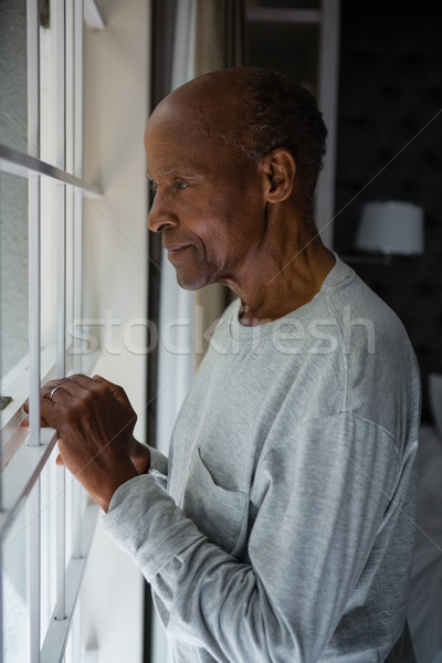 Side view of senior man looking out through window Stock photo © wavebreak_media