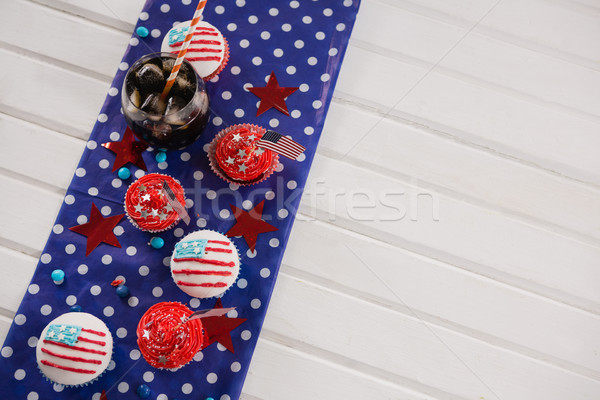 Decorated cupcakes and cold drink with 4th july theme Stock photo © wavebreak_media