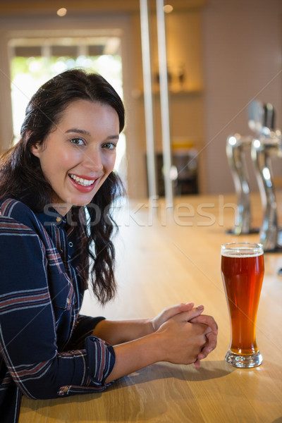 Portrait of happy beautiful woman at bar Stock photo © wavebreak_media
